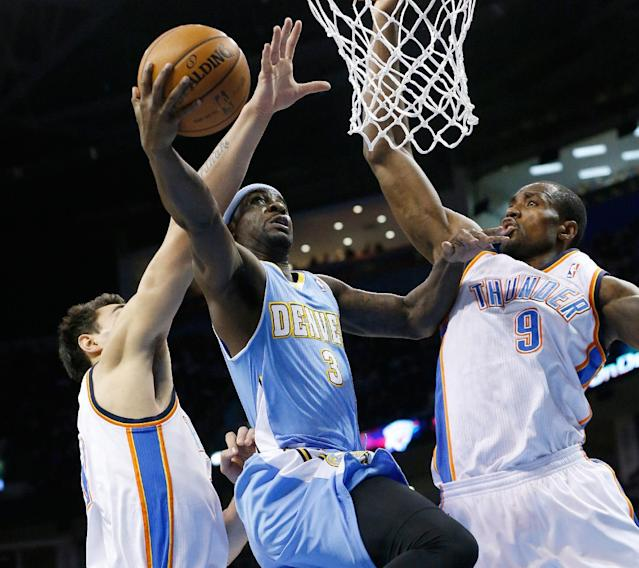 Denver Nuggets guard Ty Lawson (3) is fouled by Oklahoma City Thunder center Steven Adams as he shoots between Adams and forward Serge Ibaka (9) in the first quarter of an NBA basketball game in Oklahoma City, Monday, Nov. 18, 2013. (AP Photo/Sue Ogrocki)
