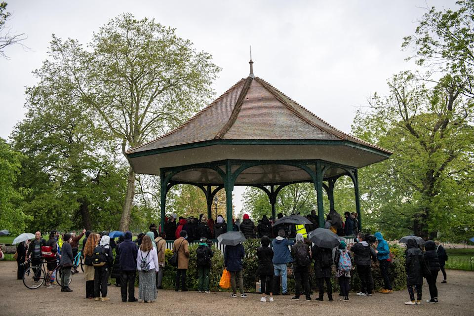 Friends and family hold a vigil to Sasha Johnson on a bandstand in Ruskin ParkGetty Images