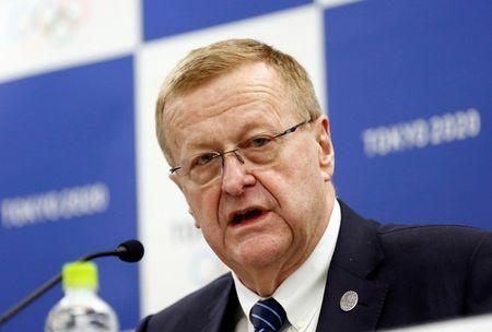 FILE PHOTO: International Olympic Committee (IOC) Vice President John Coates (L) attends a news conference in Tokyo, Japan December 13, 2017. REUTERS/Kim Kyung-Hoon