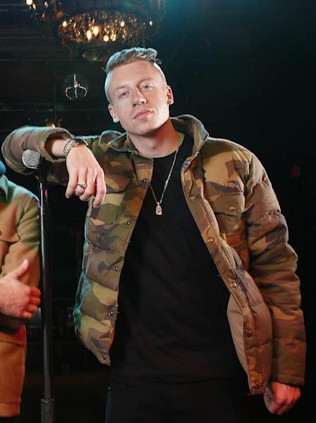 FILE - In this Nov. 20, 2012 file photo, American musician Ben Haggerty, better known by his stage name Macklemore poses for a portrait at Irving Plaza in New York. The Seattle rapper was named The Source's 2013 Man Of The Year. (Photo by Carlo Allegri/Invision/AP, File)