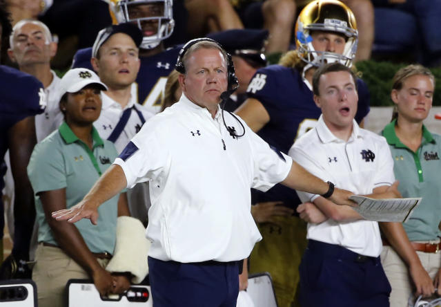 Notre Dame head coach Brian Kelly signals from the sidelineduring a game this season. (AP)