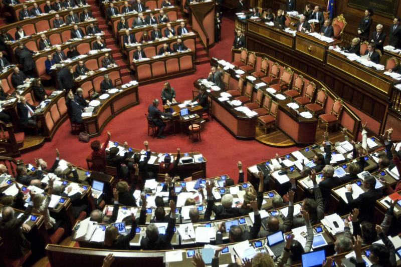 Senators vote on procedural matters as they start debating whether to kick Italian Former Premier Silvio Berlusconi out of Parliament following his tax fraud conviction, Wednesday, Nov. 27, 2013. The vote is scheduled later in the day and most analysts expect he will lose his seat. Berlusconi fans massed in front of Berlusconi's Rome palazzo for a planned rally that analysts say is essentially the start of Italy's next electoral campaign. (AP Photo/Mauro Scrobogna, Lapresse)