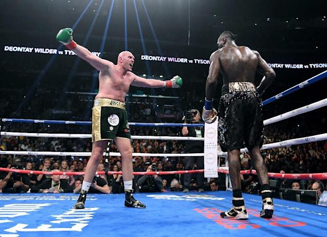 Tyson Fury taunts Deontay Wilder as they fight to a draw in their December 1 WBC heavyweight world title clash (AFP Photo/Harry How)