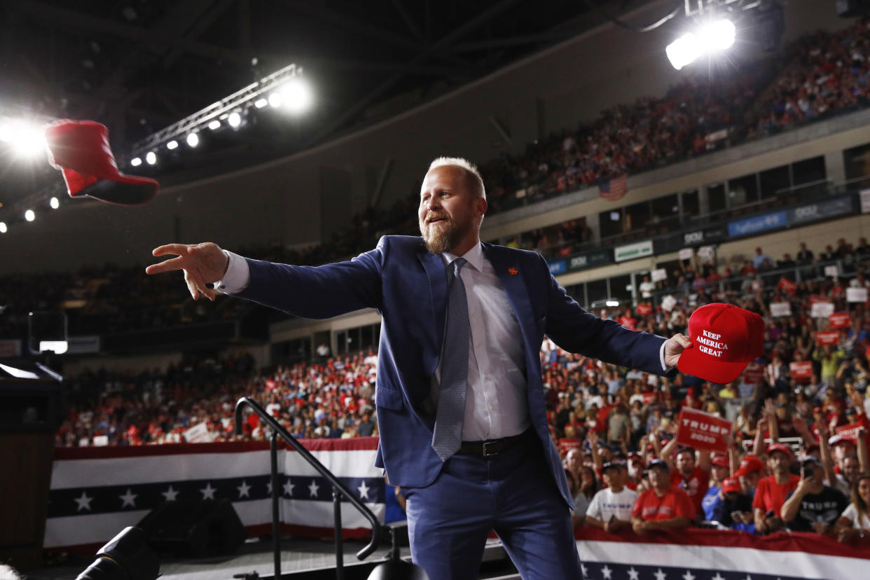 Trump campaign manager Brad Parscale tosses out hats to supporters before President Trump speaks at a campaign rally in Manchester, N.H., on Thursday. (AP Photo/Patrick Semansky)