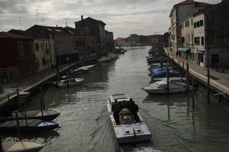 A coffin is carried in a funeral service boat after a mass at the Murano island in Venice amid the coronavirus outbreak.