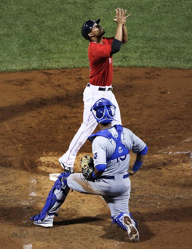 Boston Red Sox's Xander Bogaerts, top, celebrates, as Kansas City Royals catcher Salvador Perez watches, after his two-run home run during the sixth inning of a baseball game at Fenway Park in Boston, Friday, July 18, 2014. The Red Sox defeated the Royals 5-4. (AP Photo/Charles Krupa)