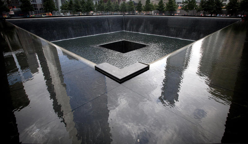 Buildings are reflected in the South Pool of the National September 11 Memorial in New York on Aug. 29, 2013. | Carlo Allegri—Reuters.
