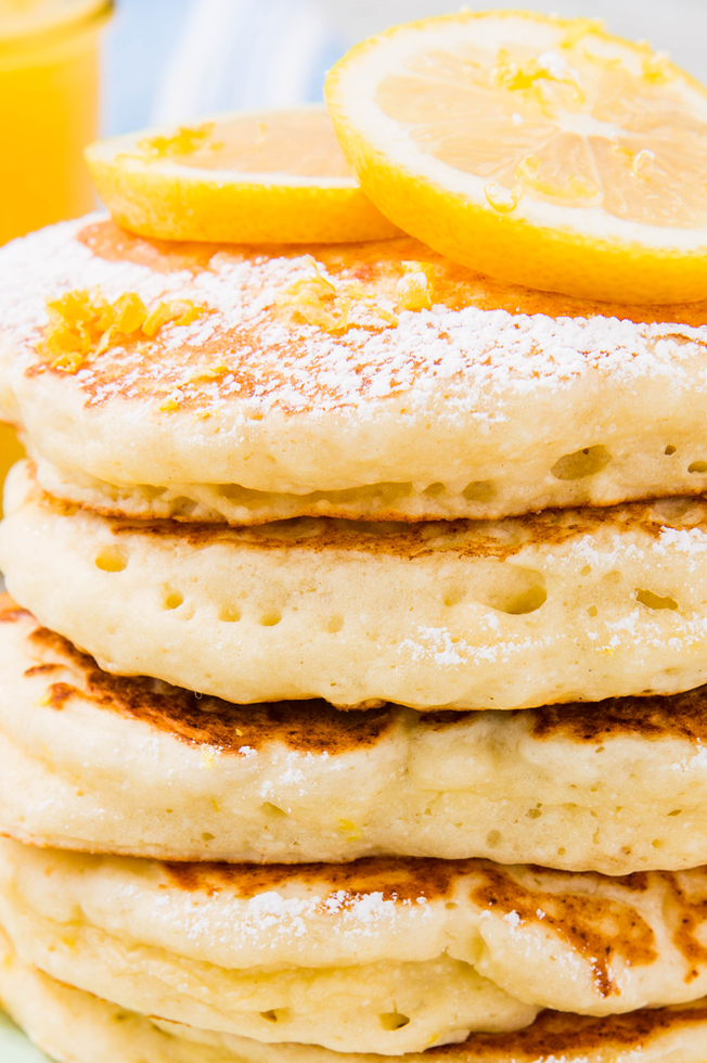 "<p>Perfectly tart with a hint of sweetness, these are the absolute-best lemon ricotta pancakes. Compared to traditional <a href=""https://www.delish.com/uk/cooking/recipes/a32846563/how-to-make-blueberry-pancakes/"" rel=""nofollow noopener"" target=""_blank"" data-ylk=""slk:buttermilk pancakes"" class=""link rapid-noclick-resp"">buttermilk pancakes</a>, they're fluffier in texture. To achieve such airy results, you need to mix your wet and dry ingredients separately. This ensures that you don't over-mix the batter, which can lead to overworking the gluten and creating a tougher pancake. We promise it's easy!</p><p>Get the <a href=""https://www.delish.com/uk/cooking/recipes/a34725455/ricotta-pancakes-recipe/"" rel=""nofollow noopener"" target=""_blank"" data-ylk=""slk:Lemon Ricotta Pancakes"" class=""link rapid-noclick-resp"">Lemon Ricotta Pancakes</a> recipe.</p>"