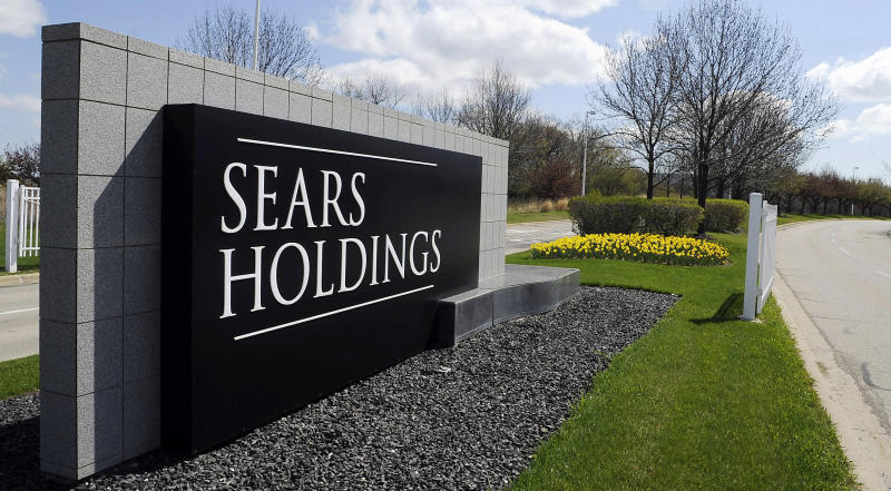 FILE - A May 4, 2011 file photo shows the entrance to the Sears Holdings Corp. Prairie Stone campus area in Hoffman Estates, Ill. Most states are doing a poor job tracking whether their tax breaks for businesses are actually spurring job growth, including some that have poured hundreds of millions of dollars into corporate incentive programs even while grappling with record deficits, according to a new report released Thursday, April 12, 2012 by the Pew Center on the States. Late last year Illinois agreed to a package of $330 million in tax breaks for Sears Holding Corp. and two companies that operate Chicago financial exchanges after they threatened to leave the state. (AP Photo/Daily Herald, Mark Welsh, File)  MANDATORY CREDIT, MAGS OUT, TV OUT