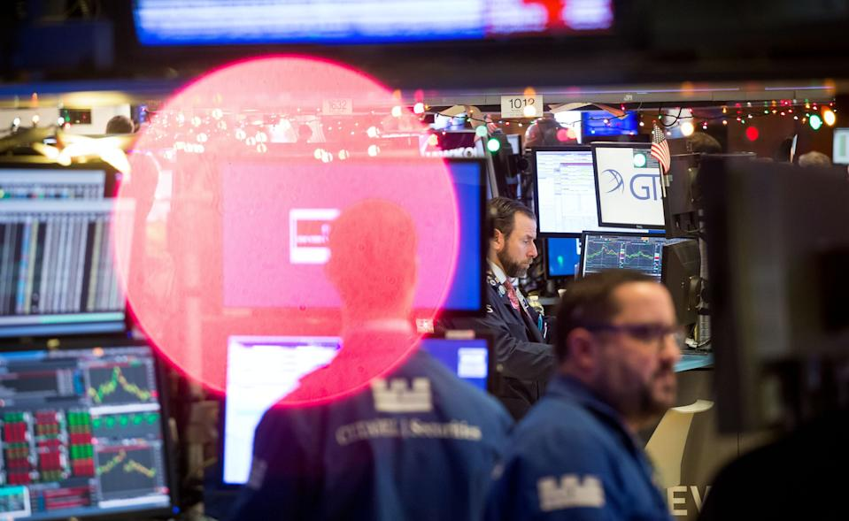 Traders work on the floor of the New York Stock Exchange (NYSE) in New York, U.S., on Monday, Dec. 10, 2018. (Photo: Michael Nagle/Bloomberg via Getty Images)