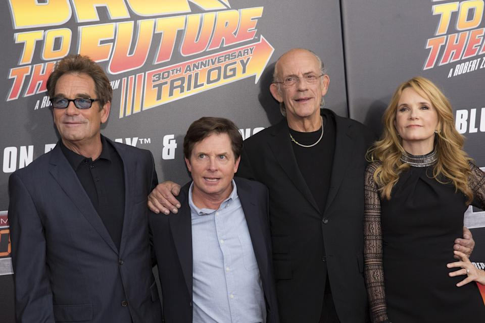 Musician Huey Lewis (L) and actors Michael J. Fox (2nd L) Christopher Lloyd and Lea Thompson (R) attend the Back to the Future 30th Anniversary screening in the Manhattan borough of New York, October 21, 2015. The film franchise is celebrating today's date as in the first sequel, the main characters traveled through time to October 21, 2015. REUTERS/Andrew Kelly  TPX IMAGES OF THE DAY