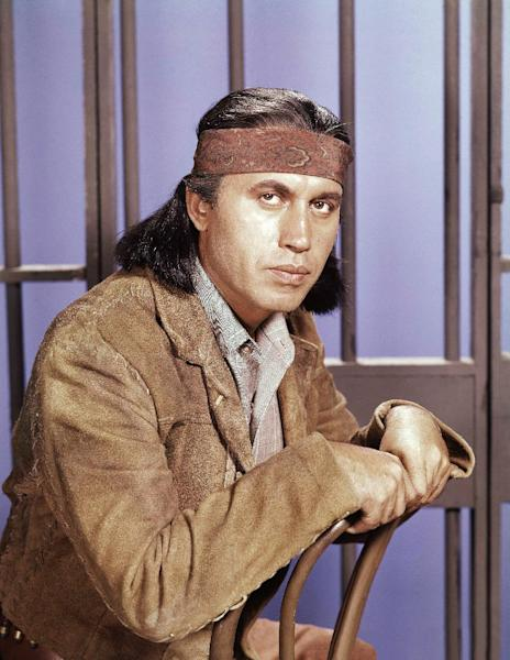 "FILE - This 1960 photo shows actor Michael Ansara on location for the TV series, ""Law of the Plainsman."" A longtime friend and spokesman for Ansara says the actor died Wednesday, July 31, 2013, at his home in California after a long illness. He was 91. (AP Photo, File)"