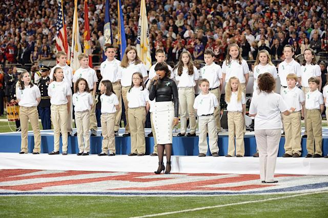 A group of 26 students from the Sandy Hook Elementary School in Newtown, Connecticut perform America the Beautiful with singer Jennifer Hudson during the Pepsi Super Bowl XLVII Pregame Show at Mercedes-Benz Superdome on February 3, 2013 in New Orleans, Louisiana. (Photo by Jeff Kravitz/FilmMagic)
