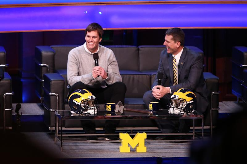 Tom Brady and Jim Harbaugh at Michigan's signing event (Getty).