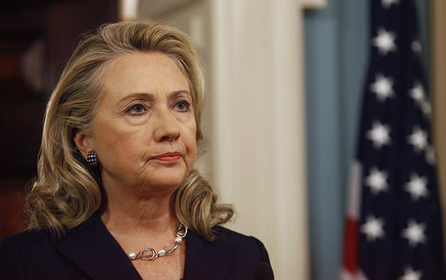 Hillary Clinton delivers remarks at the State Department in Washington on the deaths of U.S. embassy staff in Benghazi on September 12, 2012 (GARY CAMERON/REUTERS)