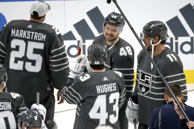 San Jose Sharks forward Tomas Hertl (48) talks with Vancouver Canucks defender Quinn Hughes (43) and Los Angeles Kings forward Anze Kopitar (11) after the Pacific Division defeated the Atlantic Division 5-4 to win the NHL All-Star final game Saturday, Jan. 25, 2020, in St. Louis. (AP Photo/Scott Kane)