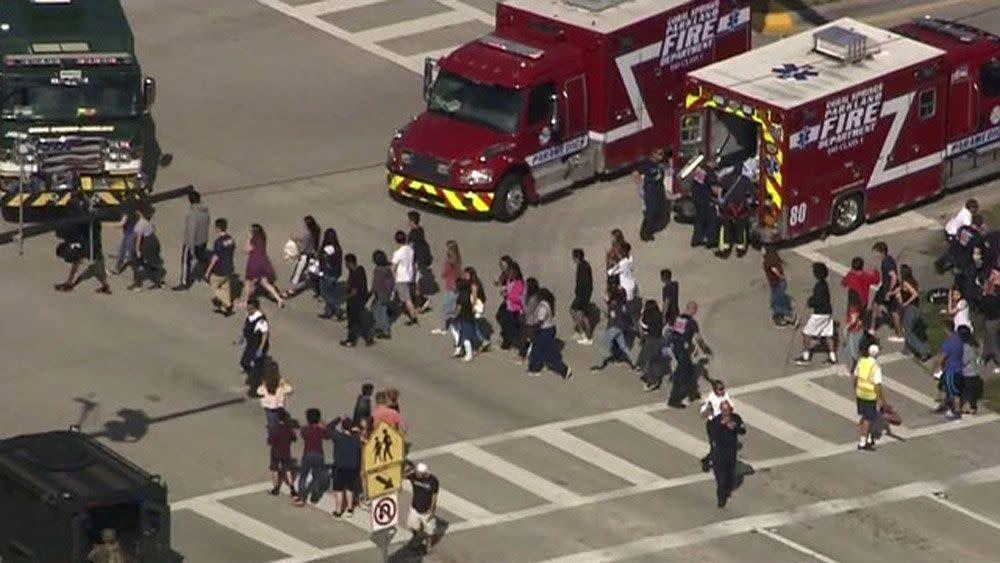 A video still shows students being evacuated from Marjory Stoneman Douglas High School.