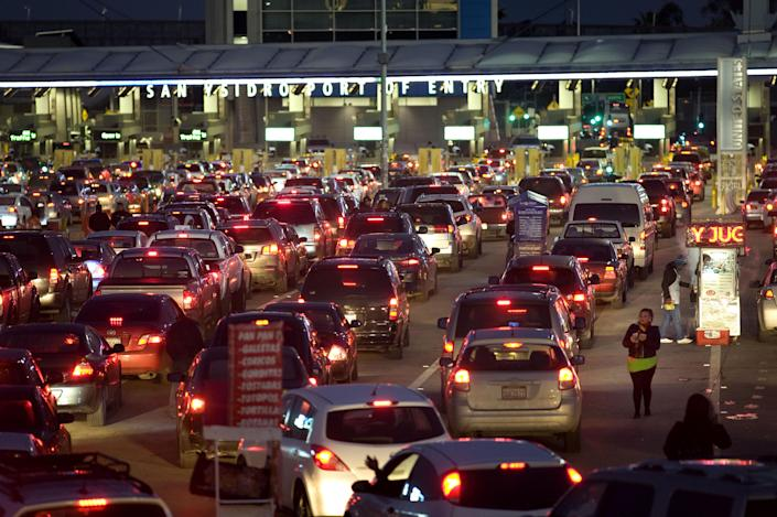 Vehicles stand in early morning traffic at the San Ysidro Port of Entry for the U.S.-Mexico border crossing in Tijuana, Mexico. (Photo: David Maung/Bloomberg via Getty Images)