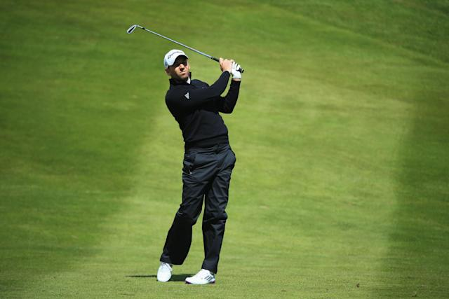 VIRGINIA WATER, ENGLAND - MAY 23: Sergio Garcia of Spain plays his second shot on the 7th during the first round of the BMW PGA Championship on the West Course at Wentworth on May 22, 2013 in Virginia Water, England. (Photo by Richard Heathcote/Getty Images)