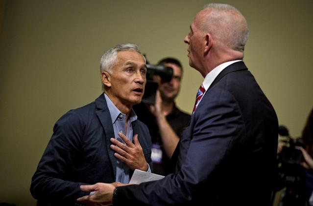 Univision reporter Jorge Ramos, left, is escorted from then candidate Donald Trump's news conference by Trump bodyguard Keith Schiller, Aug. 25, 2015. (Photo: Ben Brewer/Reuters)