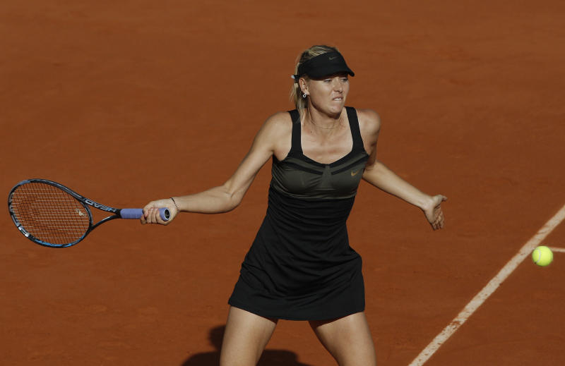 Russia's Maria Sharapova returns the ball to Czech Republic's Petra Kvitova during their semifinal match in the French Open tennis tournament at the Roland Garros stadium in Paris, Thursday, June 7, 2012.  (AP Photo/Michel Spingler)