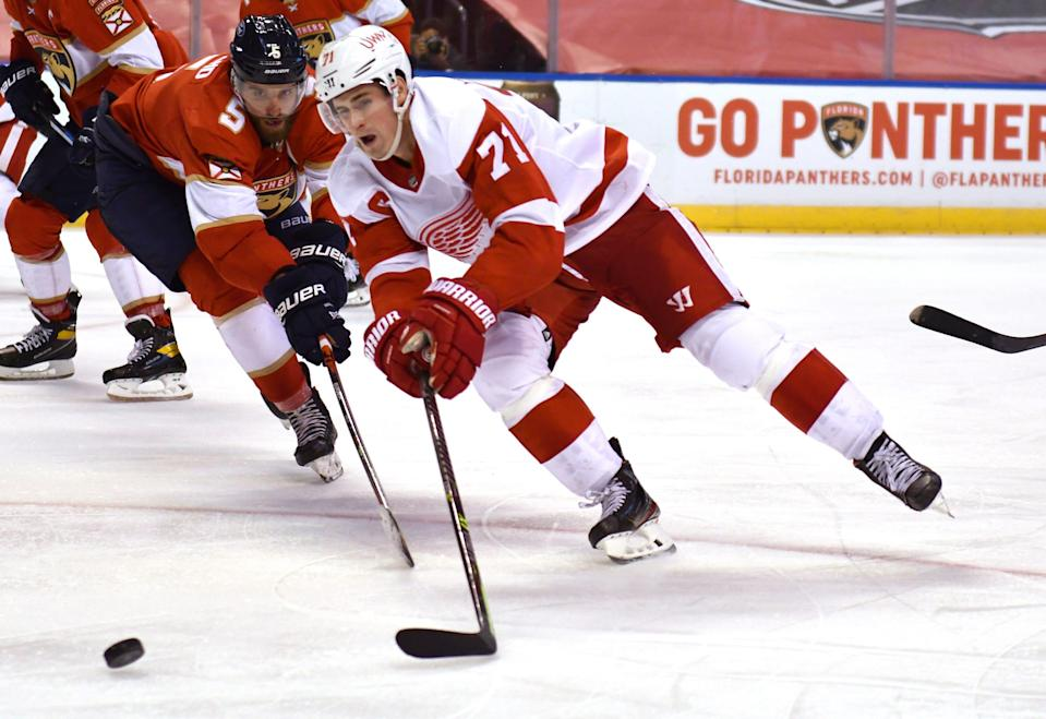 Detroit Red Wings center Dylan Larkin skates past Florida Panthers defenseman Aaron Ekblad during the third period Tuesday, Feb. 9, 2021, in Sunrise, Fla.