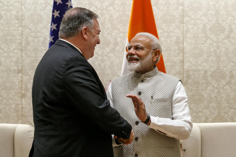 Secretary of State Mike Pompeo, left, shakes hands with Indian Prime Minister Narendra Modi, during their meeting at the Prime Minister's Residence in New Delhi, India, Wednesday, June 26, 2019. Pompeo arrived in India's capital late Tuesday after visiting Saudi Arabia, the United Arab Emirates and Afghanistan on a trip aimed at building a global coalition to counter Iran. (AP Photo/Jacquelyn Martin, Pool)