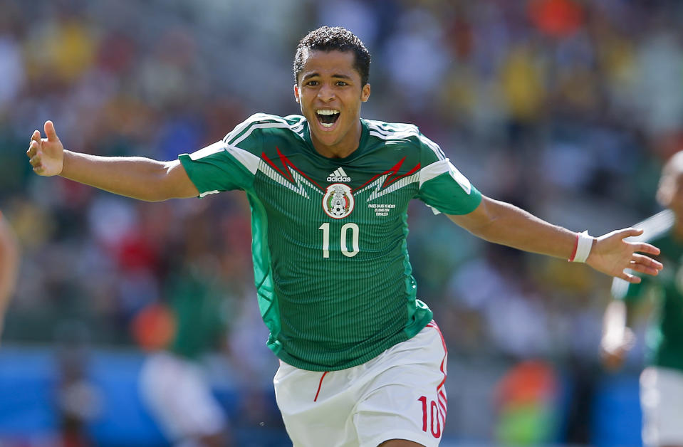 FILE - In this June 29, 2014, file photo, Mexico's Giovani dos Santos celebrates after scoring his side's first goal against Netherlands goalkeeper Jasper Cillessen during the World Cup round of 16 soccer match in Fortaleza, Brazil. The Los Angeles Galaxy have signed dos Santos to a designated player contract, adding another international star to their lineup. (AP Photo/Eduardo Verdugo)