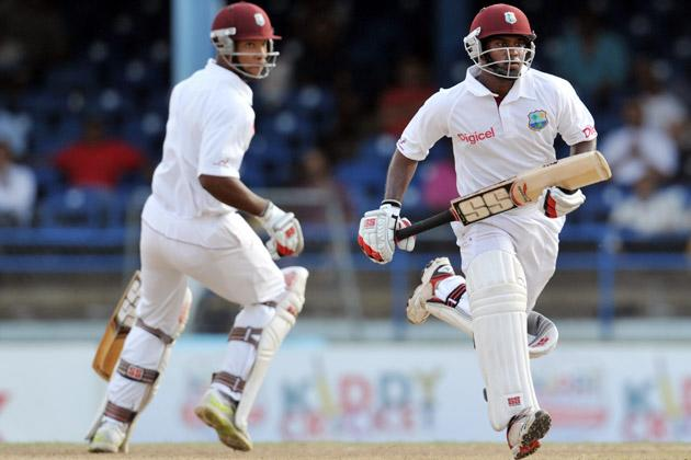 West Indies batsmen Kieran Powell (L) and Adrian Barath (R) run during the second day of the second-of-three Test matches between Australia and West Indies April 16, 2012 at Queen's Park Oval in Port of Spain, Trinidad. AFP PHOTO/Stan HONDA