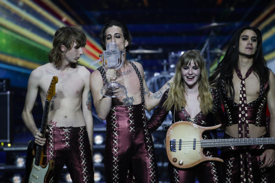 Members of the Maneskin from Italy Thomas Raggi, from left, Damiano David, Victoria De Angelis and Ethan Torchio pose on stage with the trophy after winning the Grand Final of the Eurovision Song Contest at Ahoy arena in Rotterdam, Netherlands, Saturday, May 22, 2021. (AP Photo/Peter Dejong)