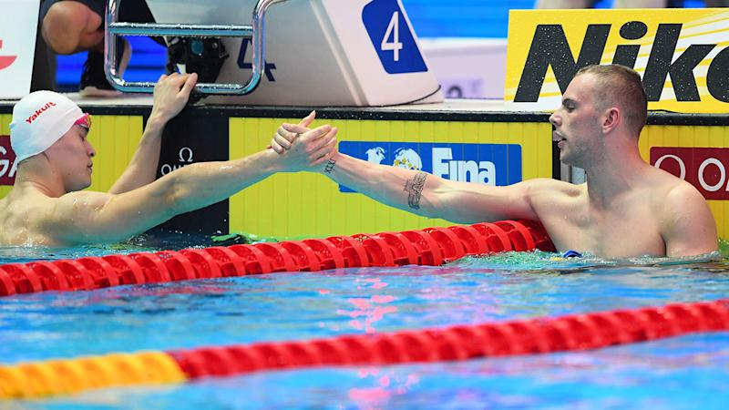 Kyle Chalmers appeared to go against the grain in shaking Sun Yang's hand. (Photo by Quinn Rooney/Getty Images)