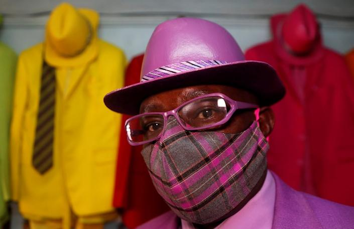 Kenyan fashion-lover James Maina Mwangi, who once told the BBC he was Africa's most stylish man, poses with some of his pieces on Friday