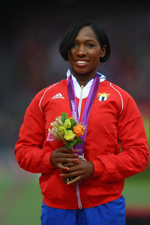 LONDON, ENGLAND - AUGUST 07: Silver medalist Yarisley Silva of Cuba poses on the podium during the medal ceremony for the Women's Pole Vault on Day 11 of the London 2012 Olympic Games at Olympic Stadium on August 7, 2012 in London, England. (Photo by Paul Gilham/Getty Images)
