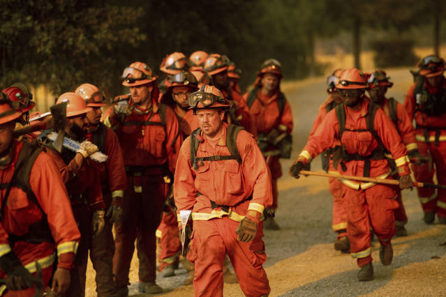 <p>Inmate firefighters leave an assignment while battling a wildfire in Guinda, Calif., July 1, 2018. (Photo: Noah Berger/AP) </p>