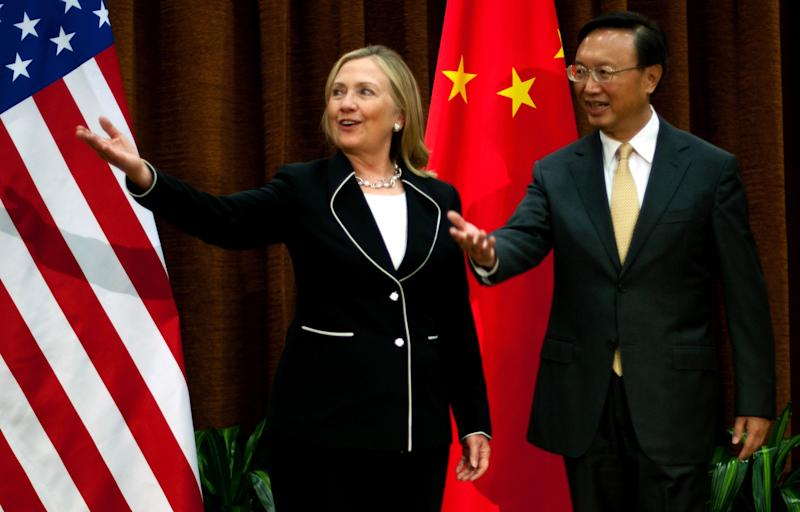 U.S. Secretary of State Hillary Rodham Clinton, left, meets with Chinese Foreign Minister Yang Jiechi, at the Ministry of Foreign Affairs in Beijing Tuesday, Sept. 4, 2012. Clinton is in Beijing to press Chinese authorities to agree to peacefully resolve disputes with their smaller neighbors over competing territorial claims in the South China Sea. (AP Photo/Jim Watson, Pool)
