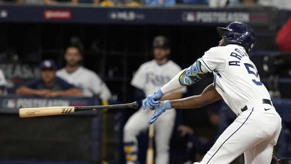 Tampa Bay Rays' Randy Arozarena loses his grip on the bat as he swings at a Boston Red Sox pitch during the second inning of Game 2 of a baseball American League Division Series, Friday, Oct. 8, 2021, in St. Petersburg, Fla. Arozarena struck out on the at-bat. (AP Photo/Steve Helber)
