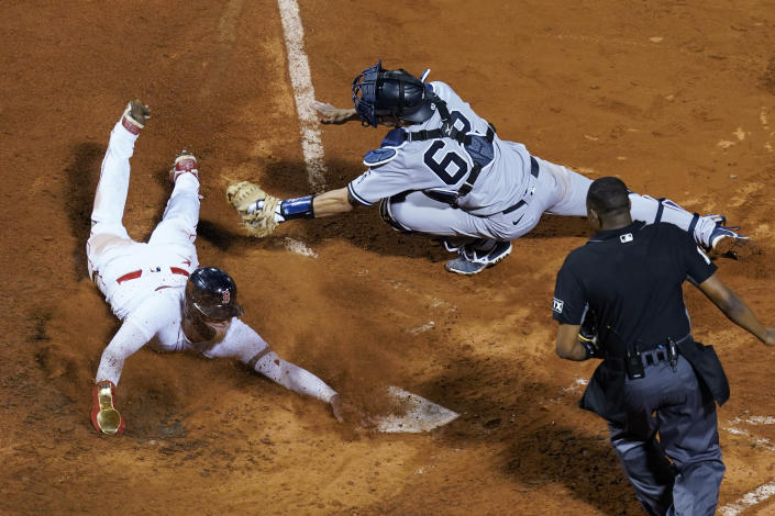 New York Yankees catcher Rob Brantly stretches for the tag but Boston Red Sox's Alex Verdugo is safe at home on a sacrifice fly by Enrique Hernandez during the seventh inning of a baseball game at Fenway Park, Thursday, July 22, 2021, in Boston. (AP Photo/Elise Amendola)
