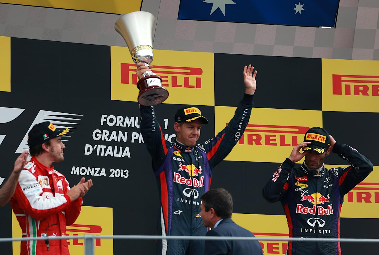 Red Bull Racing's Sebastian Vettel with the trophy on the podium after victory in the Italian Grand Prix and the Autodromo Nazionale Monza, Monza, Italy.