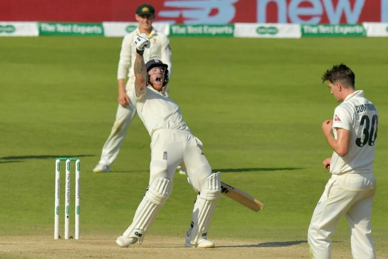 England's Ben Stokes celebrates hitting the winning runs on the fourth day of the third Ashes cricket Test match between England and Australia at Headingley