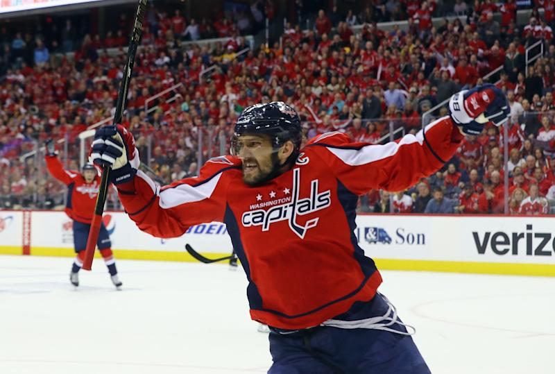 Capitals overwhelm Penguins 5-2 to force Game 7