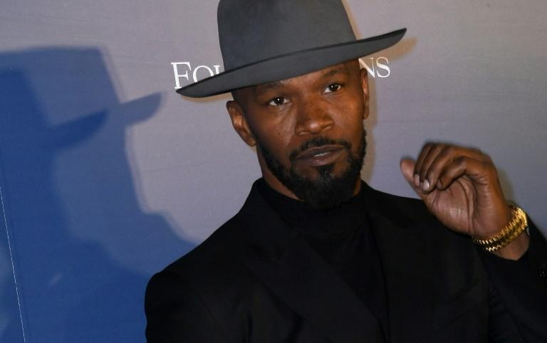 "Jamie Foxx, who stars in courthouse drama ""Just Mercy,"" called on America to tackle the ""sinister undercurrent"" of racism in its justice system (AFP Photo/VALERIE MACON)"