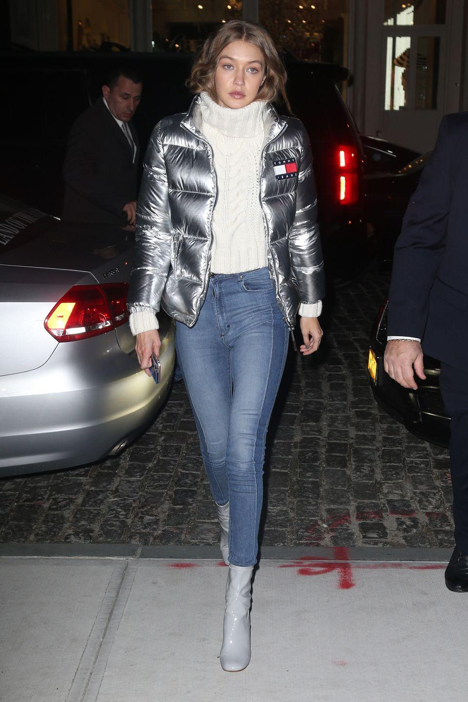 <p>In a Tommy Hilfiger puffer jacket, white cowl neck sweater, two-tone skinny jeans and gray patent leather booties while out in NYC.</p>
