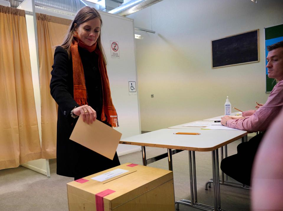Iceland's Prime Minister Katrin Jakobsdottir and top candidate of the Left Green Movement casts a ballot at a polling station in Iceland's capital Reykjavik on Sept. 25, 2021, during the country's parliamentary elections to elect members of the Althing.