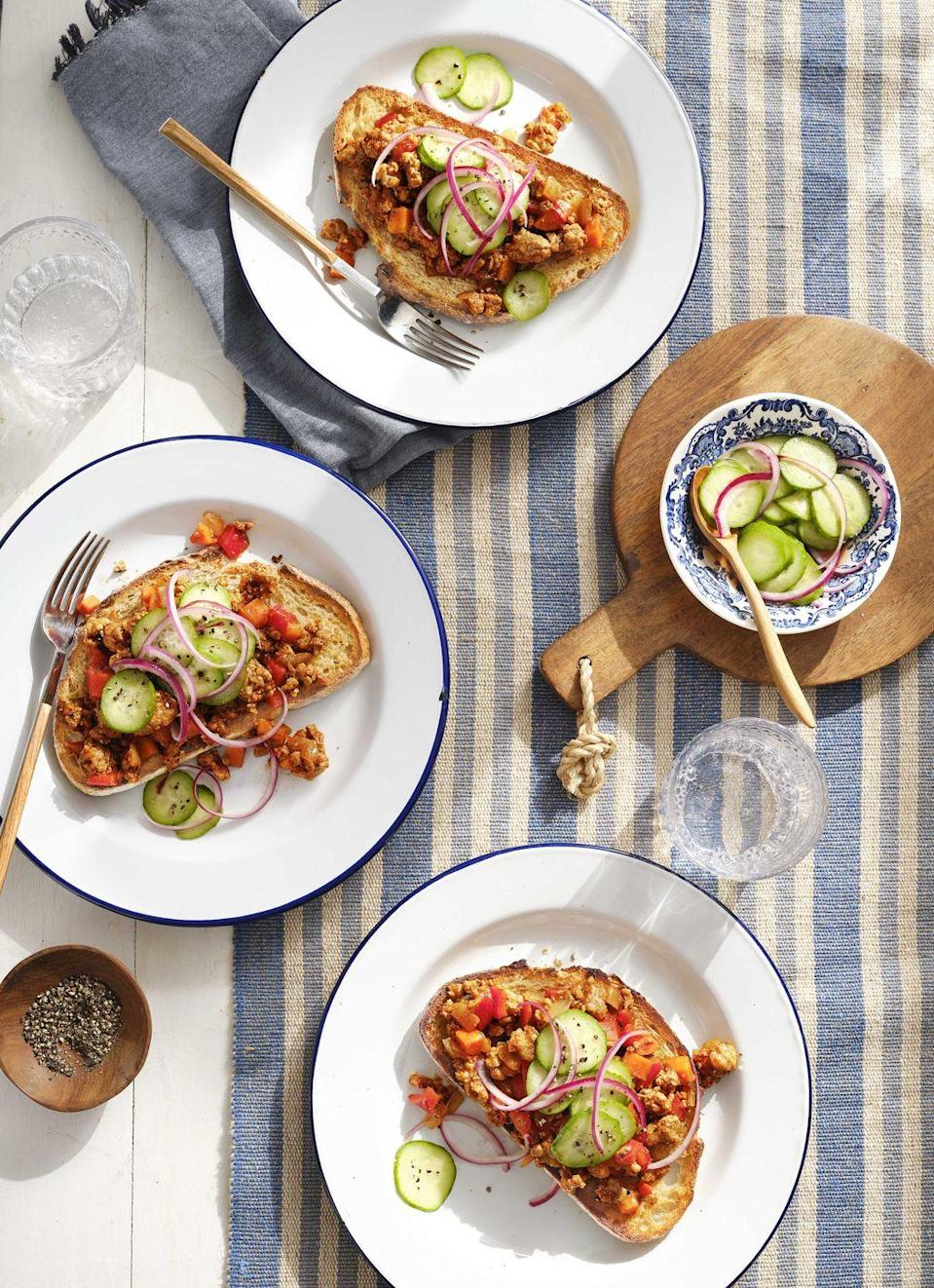 """<p>The kids will come running when you serve-up this fast version of a perennial favorite. Ground turkey or chicken replaces the usual ground beef, and a fresh cucumber onion relish tops it all off!</p><p><strong><a href=""""https://www.countryliving.com/food-drinks/a30417966/ground-turkey-sloppy-joes-recipe/"""" rel=""""nofollow noopener"""" target=""""_blank"""" data-ylk=""""slk:Get the recipe"""" class=""""link rapid-noclick-resp"""">Get the recipe</a>.</strong> </p>"""
