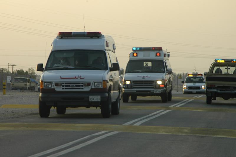 Saudi ambulances and police vehicles rush to the site of an Al-Qaeda attack on an oil processing plant in Abqaiq on February 24, 2006