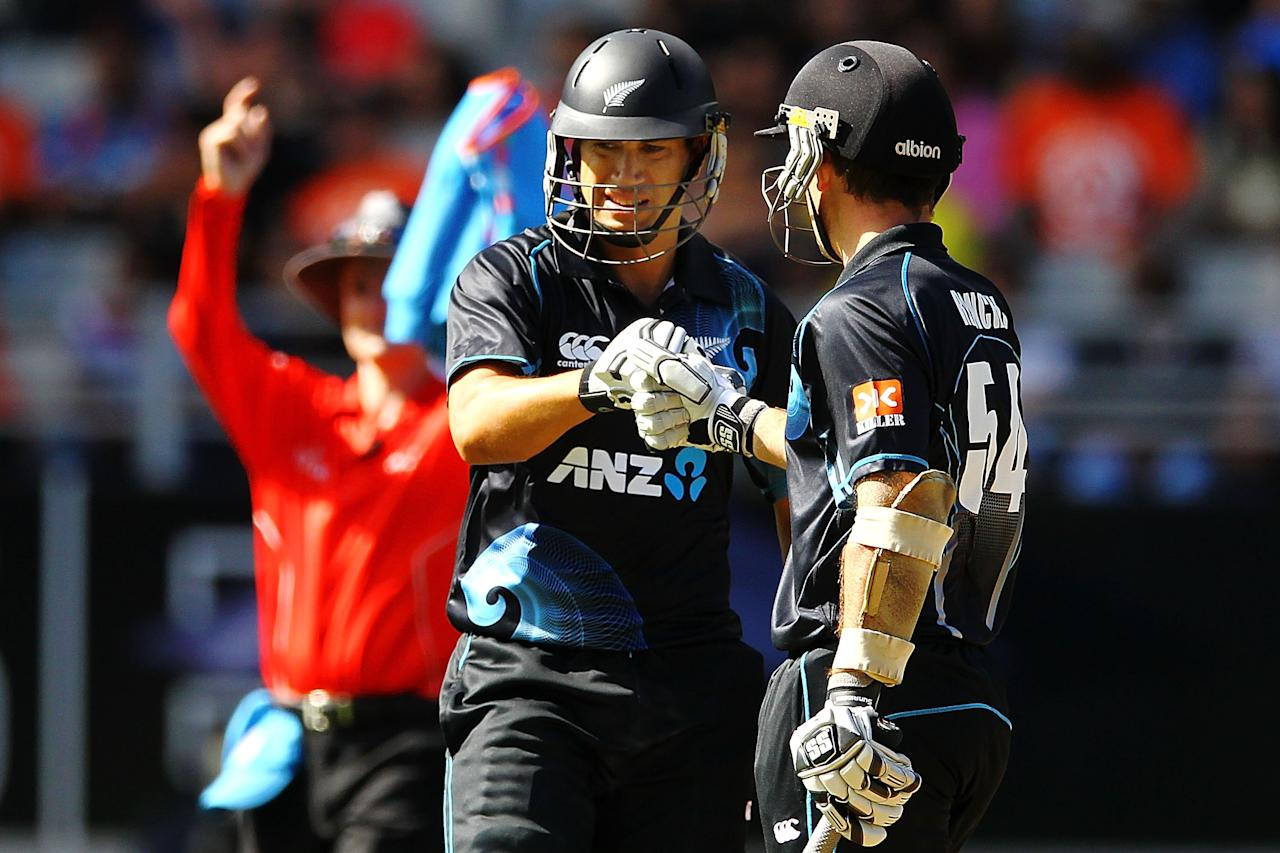 AUCKLAND, NEW ZEALAND - JANUARY 25: Ross Taylor of New Zealand celebrates hitting a six with teammate Luke Ronchi during the One Day International match between New Zealand and India at Eden Park on January 25, 2014 in Auckland, New Zealand.  (Photo by Anthony Au-Yeung/Getty Images)