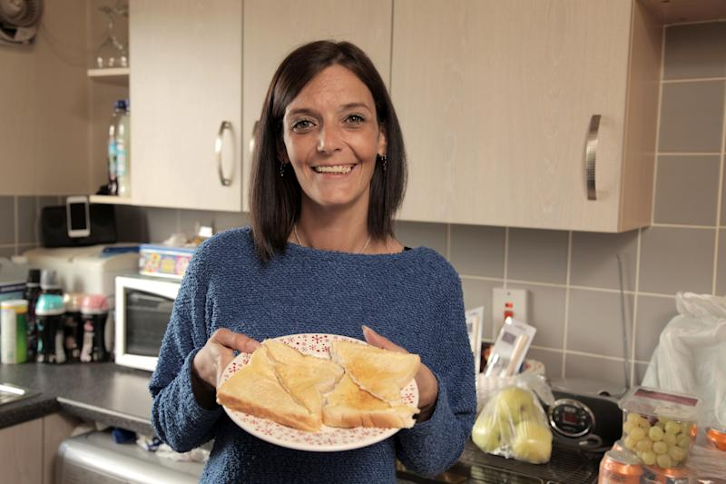 *** EXCLUSIVE - VIDEO AVAILABLE*** MONTROSE, SCOTLAND - 8 SEPTEMBER: Jill Hayman holding a typical meal - buttered toast, Montrose, Scotland, 8 September 2017. A PUB landlord is so afraid of certain foods just the sight and smell of them can drive her to panic attacks and make her physically sick. Jill Hayman, 36, from Montrose Scotland, lives off a diet primarily made up of crisp sandwiches and fizzy drinks and has never sat down to eat a proper hot meal with a knife and fork. Jill has a list of approximately 18 food and drink items she can stomach what she refers to as her safe foods; these include fizzy and energy drinks, jelly sweets, crisps and chocolate, with bread making up the majority of her meals. Unsurprisingly Jill gets through, on average, seven loaves of bread per week. PHOTOGRAPH BY Jacek Hubner / Barcroft Images (Photo credit should read Jacek Hubner / Barcroft Images / Barcroft Media via Getty Images)
