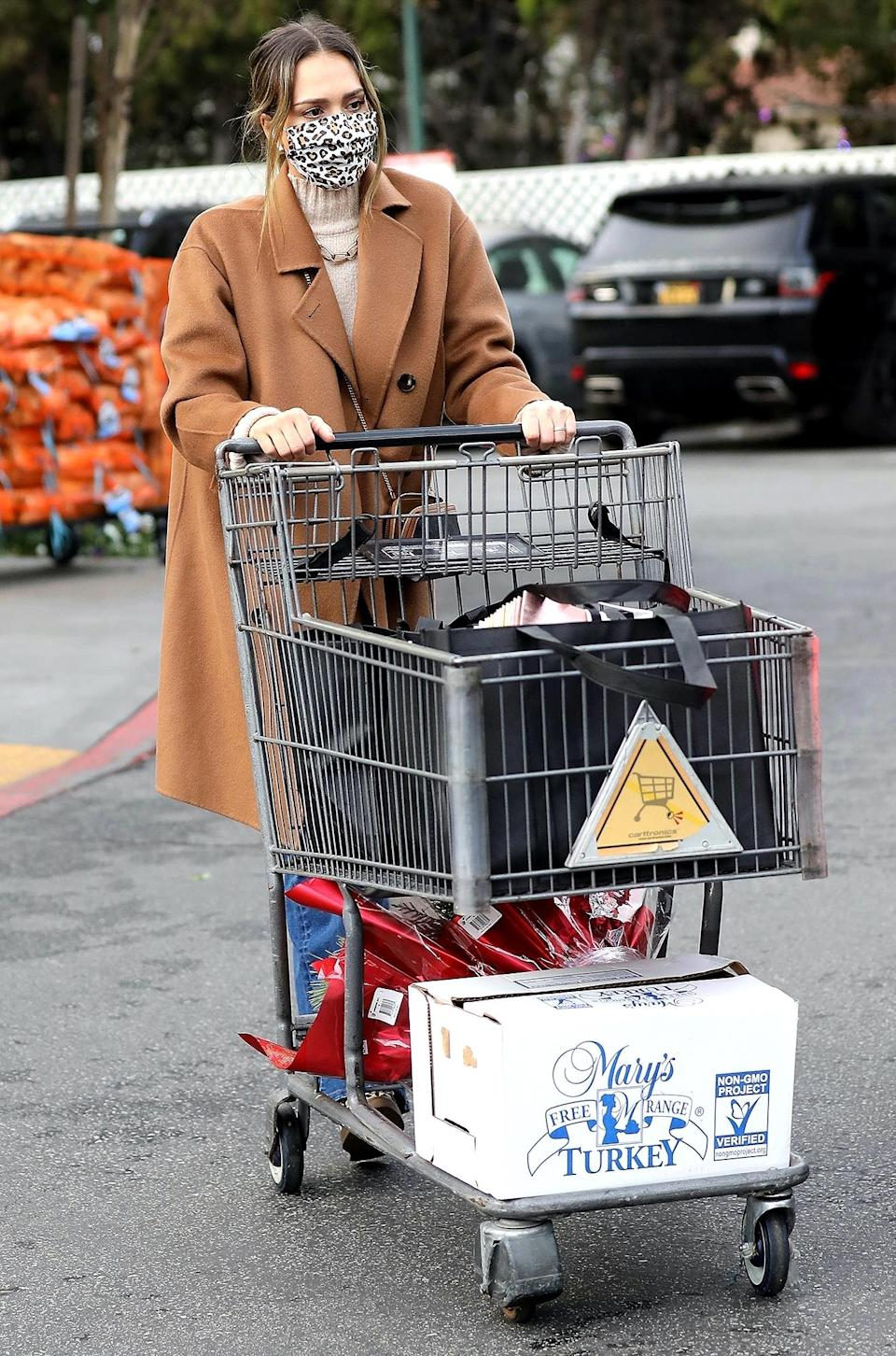 <p>Jessica Alba leaves Bristol Farms after grocery shopping ahead of Christmas on Thursday in Beverly Hills.</p>