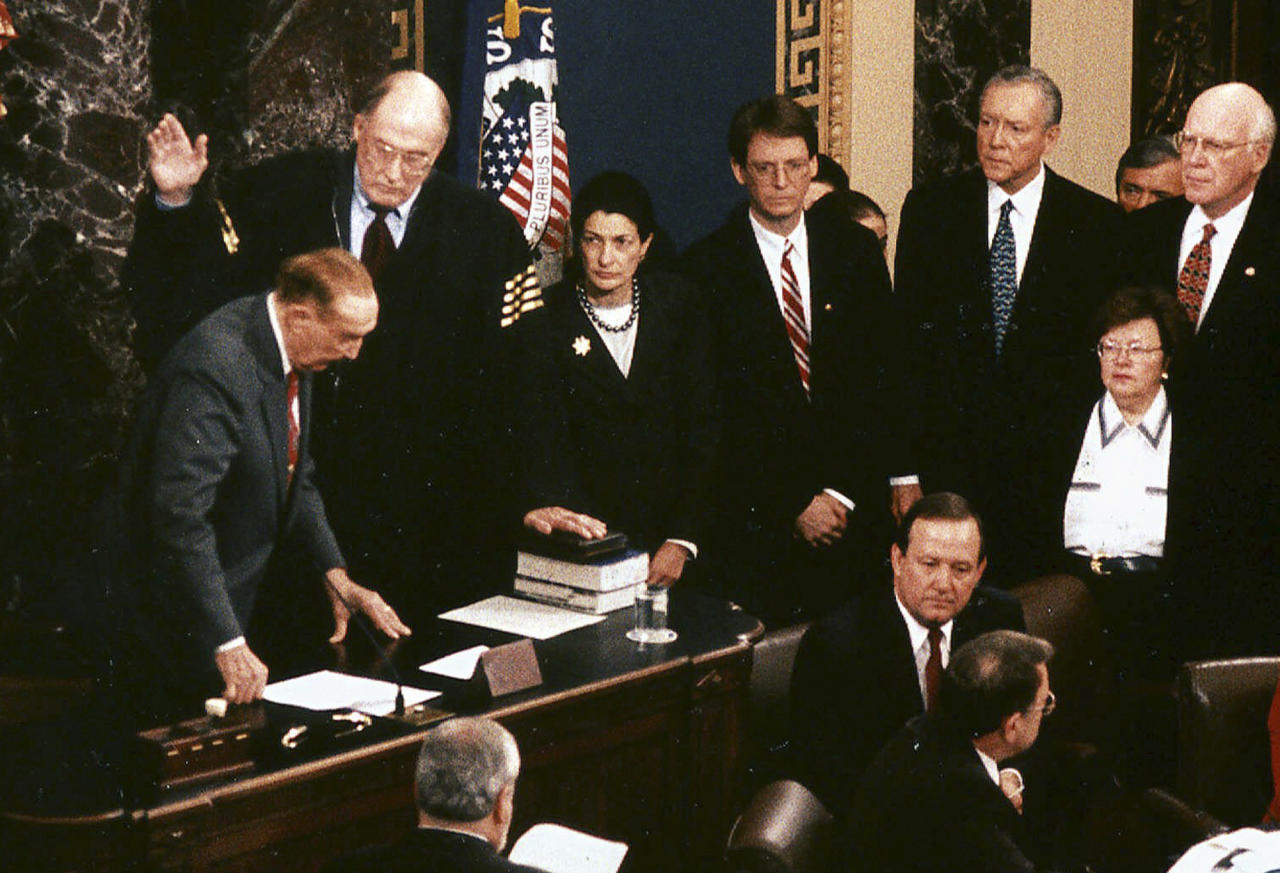 FILE - In this Jan. 7, 1999 file photo released by the U.S. Senate, as senators look on, Chief Justice William Rehnquist, second from left, is sworn in by Sen. Strom Thurmond, R-S.C., left, to preside over the impeachment trial of President Clinton in the Senate Chambers in Washington. Attending left to right on the top row are: Sen. Thurmond, Chief Justice Rehnquist, Sen. Olympia Snowe, R-Maine., unidentified, Sen. Orrin Hatch, R-Utah, Sen. Barbara Mikulski, D-Md., and Sen Patrick Leahy, D-Vt. Snowe, who has served 33 years in Congress, released a statement Tuesday, Feb. 28, 2012 saying that she will not run for re-election. (AP Photo/U.S. Senate, File)