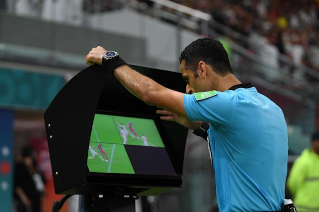 Referee Abdulrahman Al-Jassim reviews the challenge on Mane (Photo by Mike Hewitt - FIFA/FIFA via Getty Images)